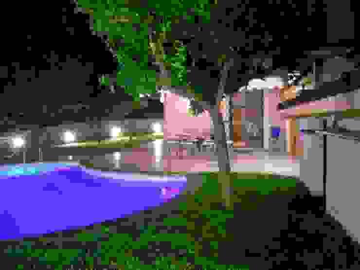 Modern garden by PECORAMELLOarchitetti Modern
