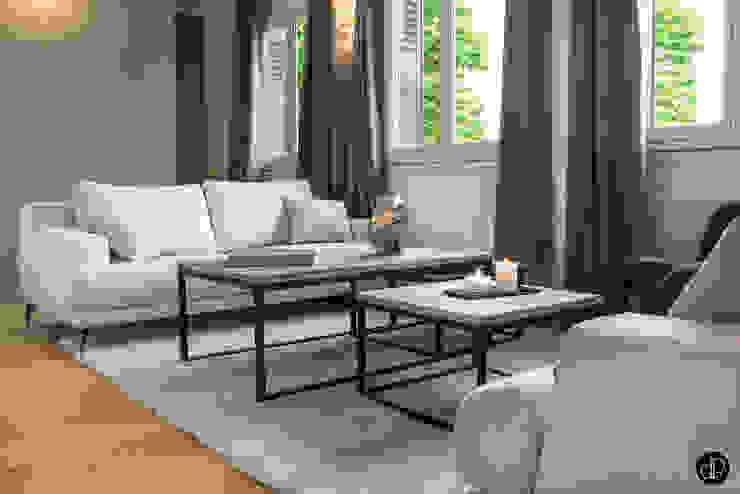 Le salon façon réception Cuisine moderne par Décoration Parisienne Moderne