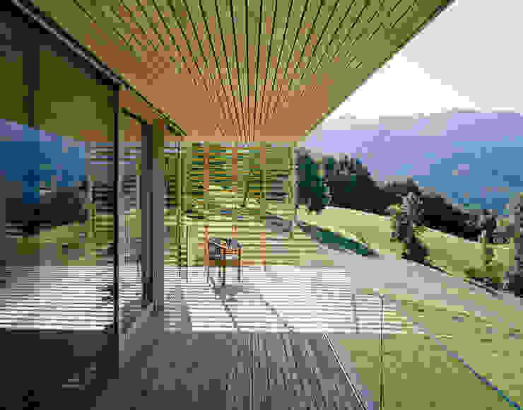Modern terrace by Dietrich | Untertrifaller Architekten ZT GmbH Modern