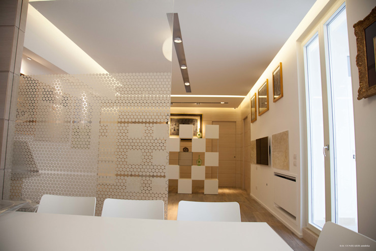 Modern living room by G/G associati studio di ingegneria e architettura _ing.r.guglielmi_arch.a.grossi Modern