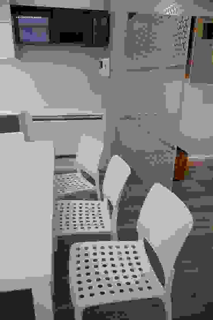 Modern dining room by G/G associati studio di ingegneria e architettura _ing.r.guglielmi_arch.a.grossi Modern