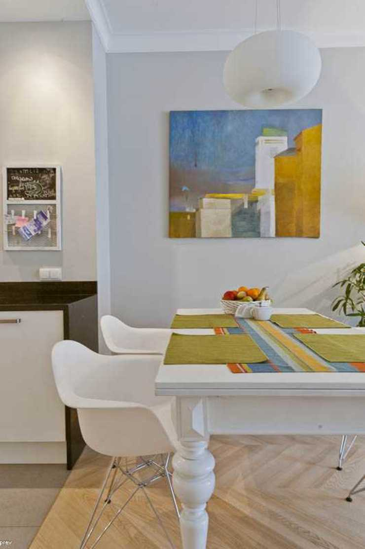 Eclectic style dining room by MATELIER Eclectic