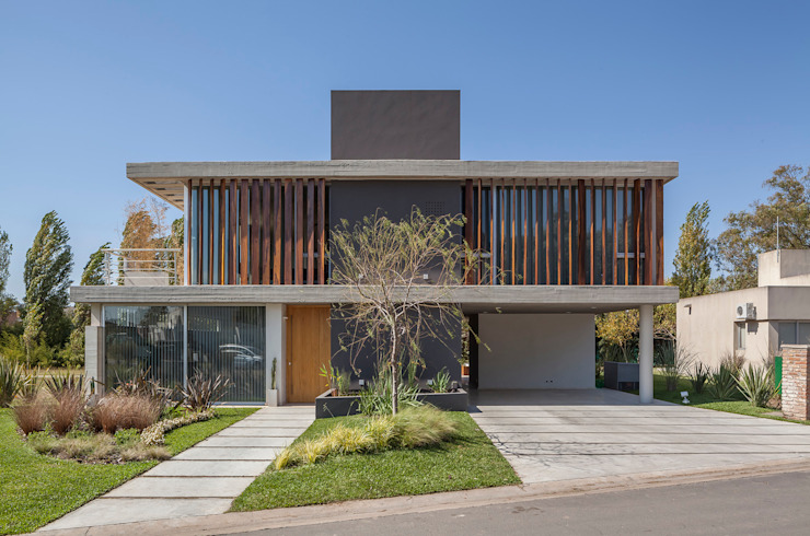 Modern houses by ESTUDIO GEYA Modern