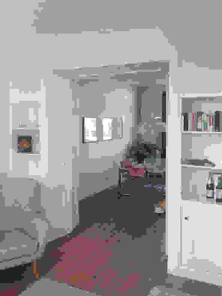 zicht vanuit de woonkamer met volledig geopende deuren van Obliq Architectuur Klassiek