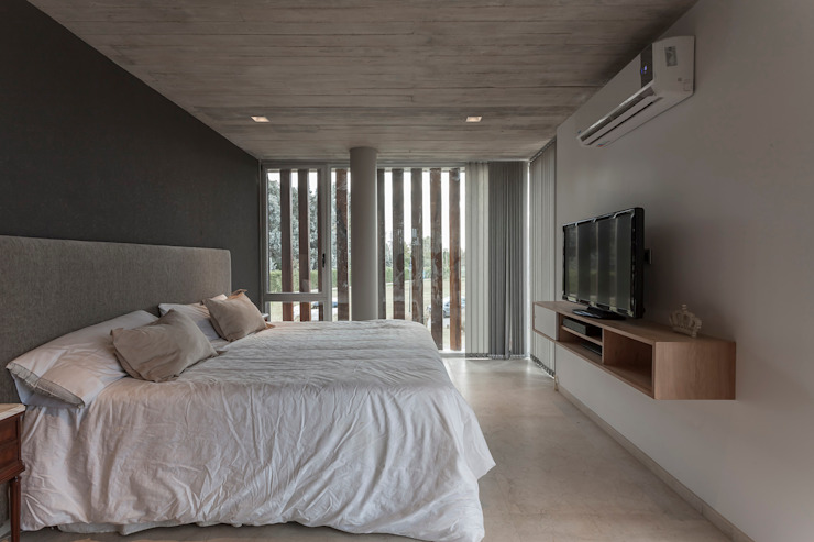Modern style bedroom by ESTUDIO GEYA Modern