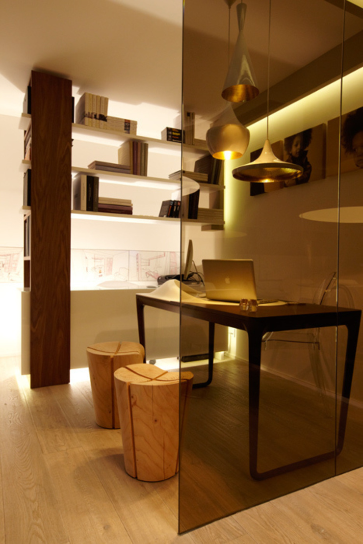 Office-showroom Negozi & Locali commerciali di FRANCESCO CARDANO Interior designer