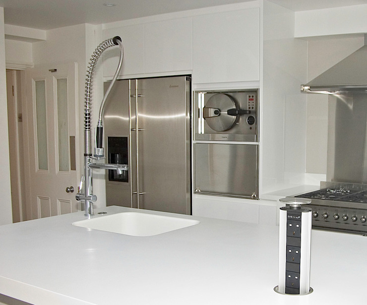 White gloss kitchen with Corian worktops by Greengage Interiors Modern