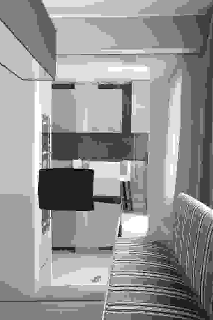 verso la cucina Sala da pranzo moderna di STUDIO PAOLA FAVRETTO SAGL Moderno Cemento