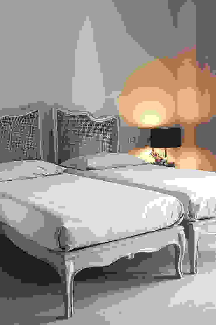 La camera degli ospiti Camera da letto moderna di STUDIO PAOLA FAVRETTO SAGL Moderno Legno Effetto legno