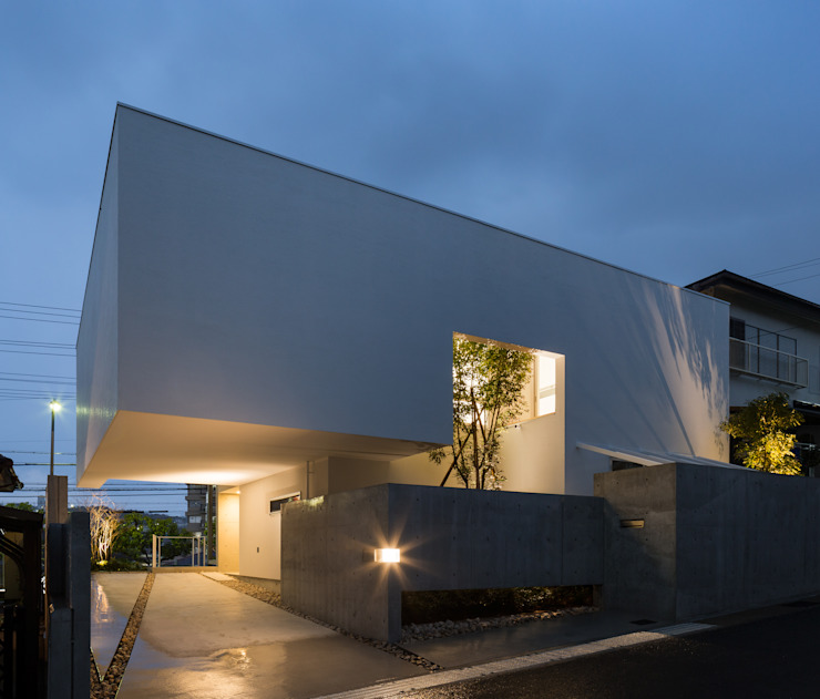 Casas de estilo  por Kenji Yanagawa Architect and Associates,
