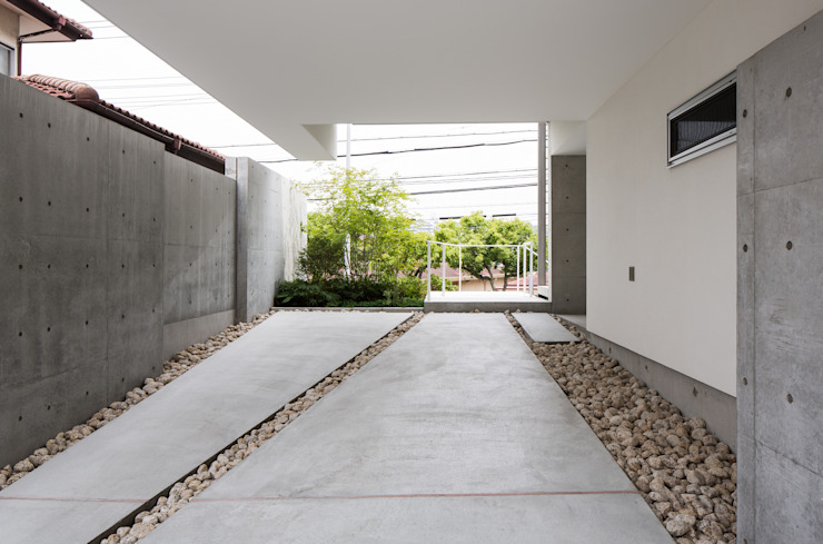 Moderne Garagen & Schuppen von Kenji Yanagawa Architect and Associates Modern