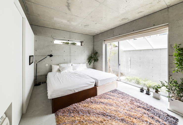 Chambre de style  par Kenji Yanagawa Architect and Associates, Moderne