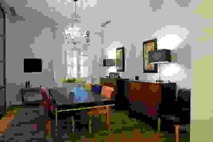 una casa deco' archbcstudio Sala da pranzo moderna