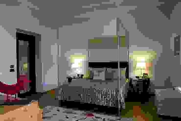 una casa deco' archbcstudio Camera da letto moderna