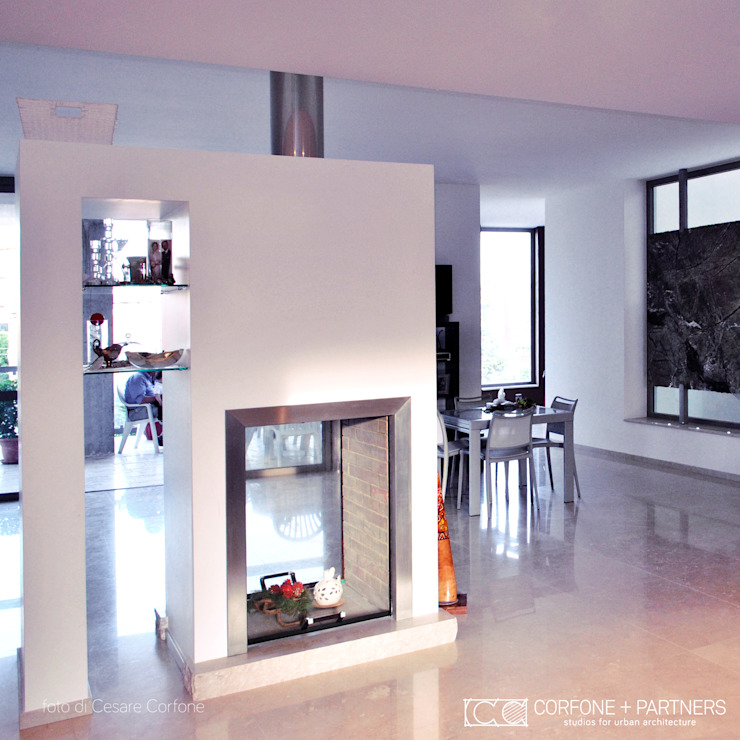 Modern Living Room by CORFONE + PARTNERS studios for urban architecture Modern
