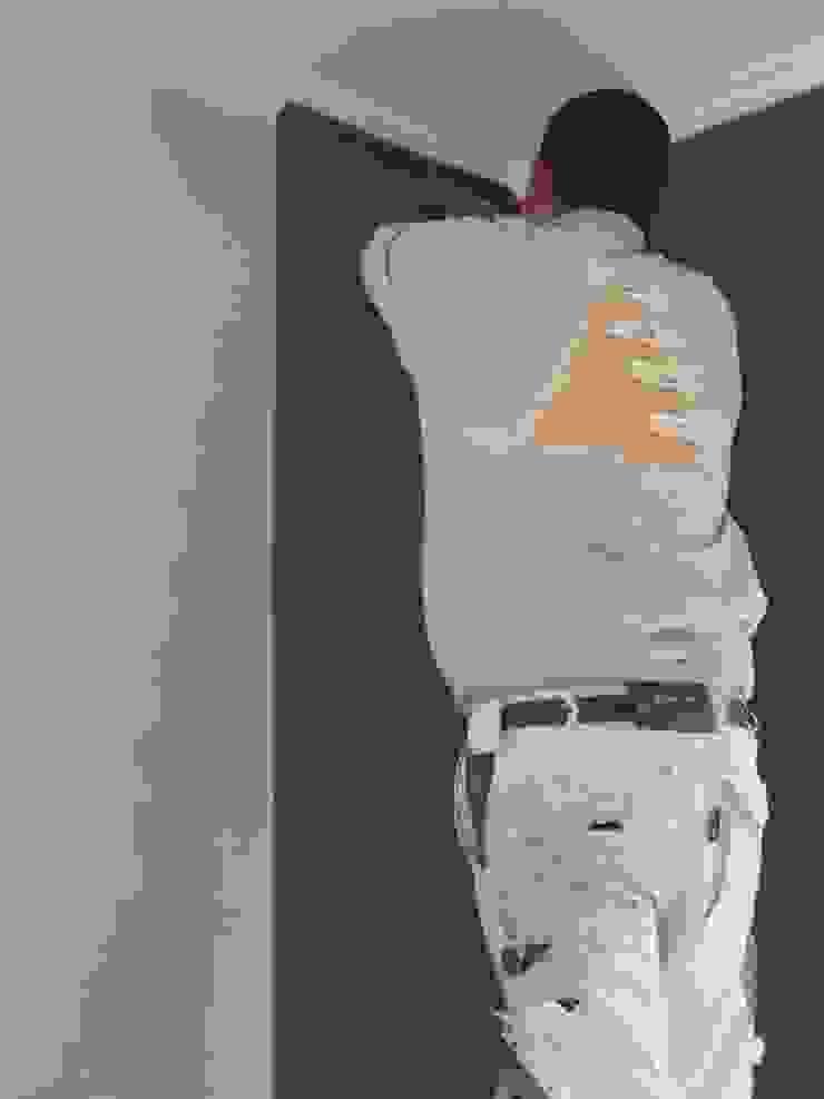 Recouvrement des murs par Artisans @rt Déco Sprl.