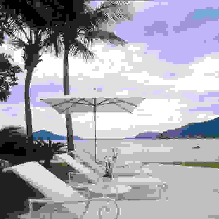 Casa Iporanga Piscinas tropicais por Studio Oscar Mikail Tropical