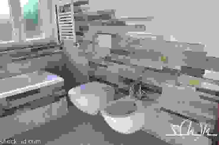 Casas de banho rústicas por Shock-Id Rústico