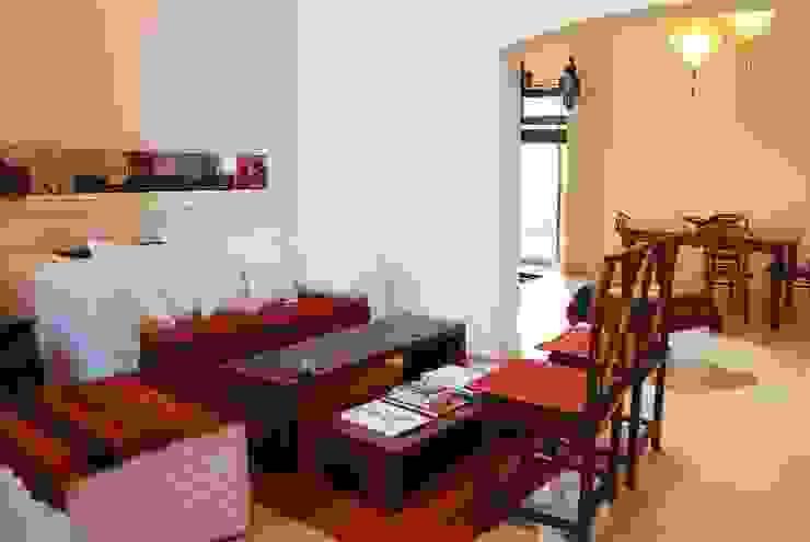 Гостиные в эклектичном стиле от Parrado Arquitectura Эклектичный