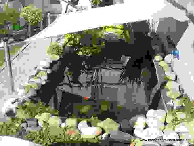 Varanda, marquise e terraço  por Textile Sonnenschutz- Technik ,