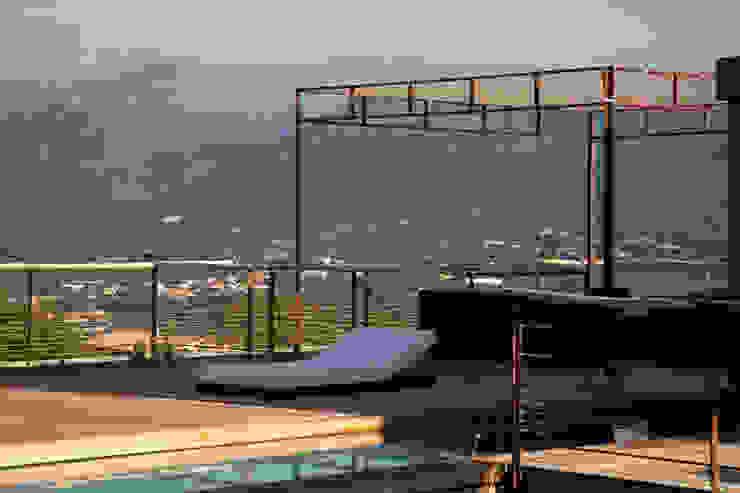Mediterranean style pool by Vezzoni Associés Mediterranean