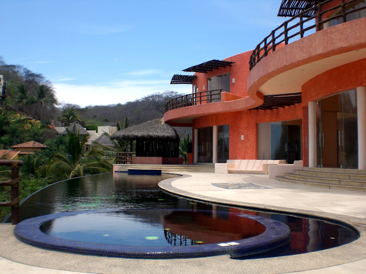 Casa Mariposa Albercas tropicales de arqflores / architect Tropical