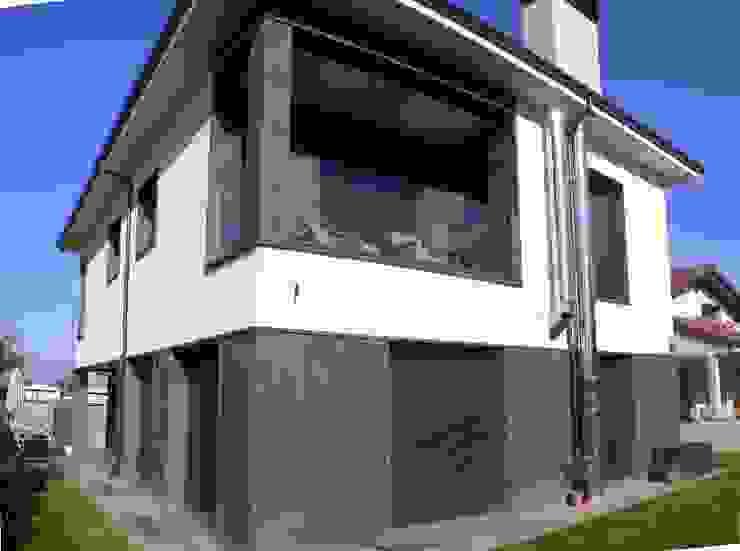 fachada de Muneta Arquitectura S.L.P. Minimalista Piedra