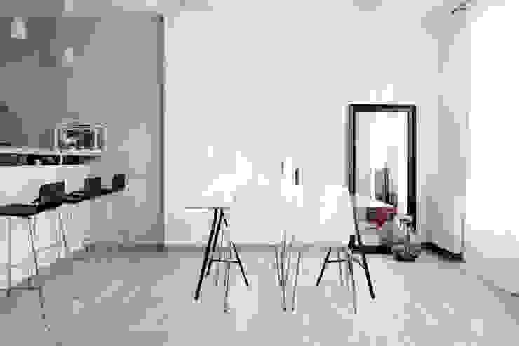 Salas de estar  por Grazia Architecture, Moderno