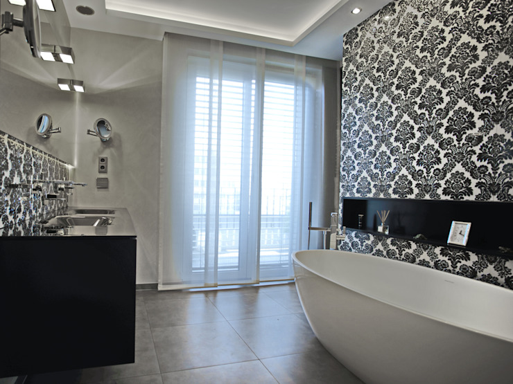 Bathroom by UTH living stone GmbH