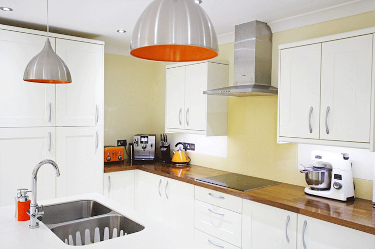White Kitchen Units With Orange Accents by Rebecca Coulby Interiors