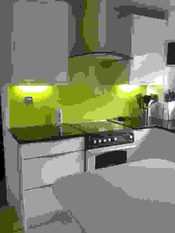 White Gloss Kitchen with Yellow Glass Splashback by Henley McKay Kitchens