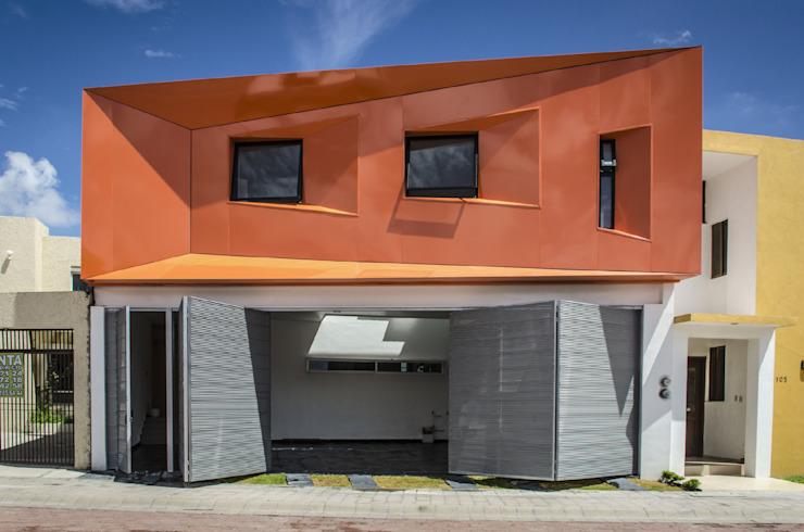Houses by PLASTIK ARQUITECTOS, Modern