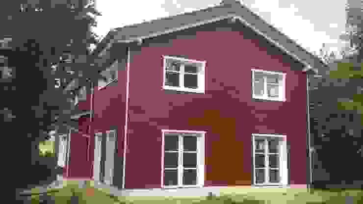 Scandinavian style houses by eMKo-Conzeptbau Scandinavian