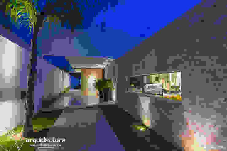 Casa Kopché de Grupo Arquidecture Moderno Piedra