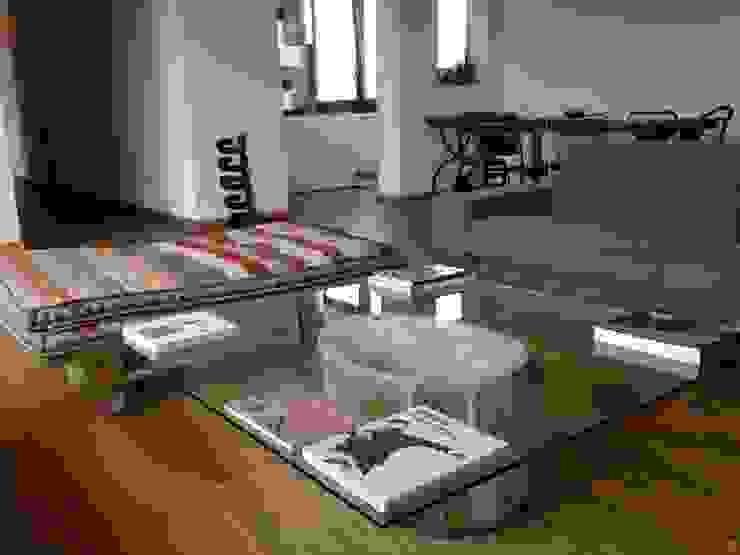 First Soggiorno eclettico di V V | architettura & Interni Eclettico