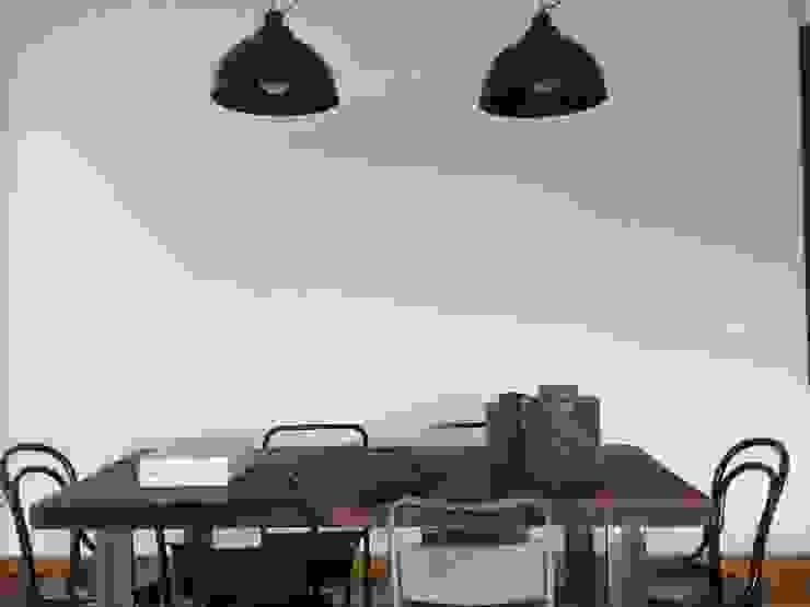 First Sala da pranzo eclettica di V V | architettura & Interni Eclettico