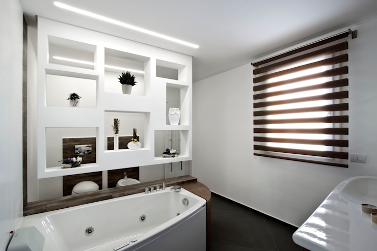 Casas de banho modernas por Laboratorio di Progettazione Claudio Criscione Design Moderno