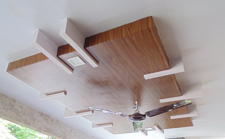 Wooden Films on Plaster of Paris Ceiling with Designer Effect: modern  by Floor2Walls,Modern