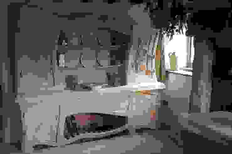 Sculptural Organic Handmade Bespoke kitchen Furniture Carved Wood Design Bespoke Kitchens.