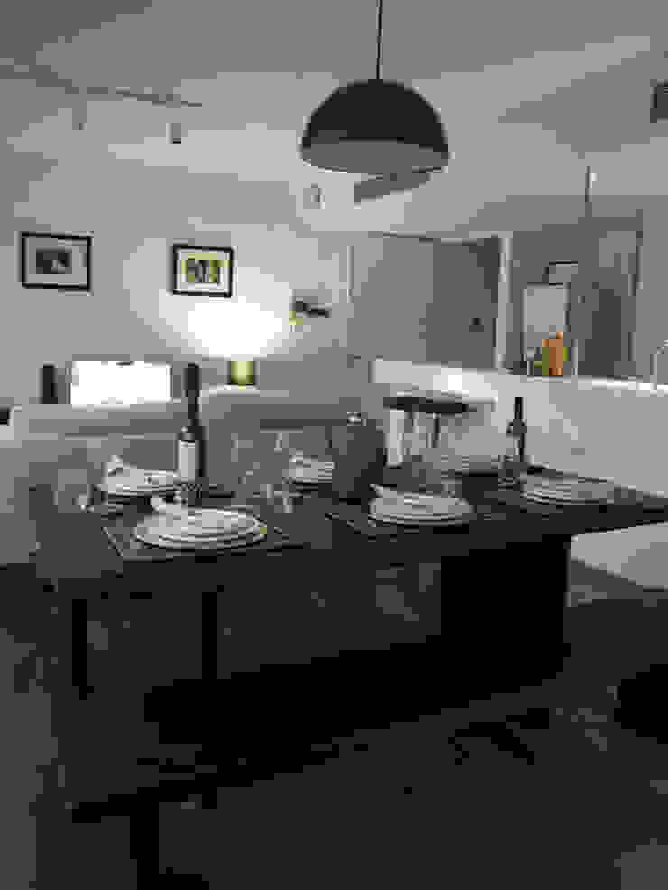 Dining / Living Modern living room by elliot James Pte Ltd Modern