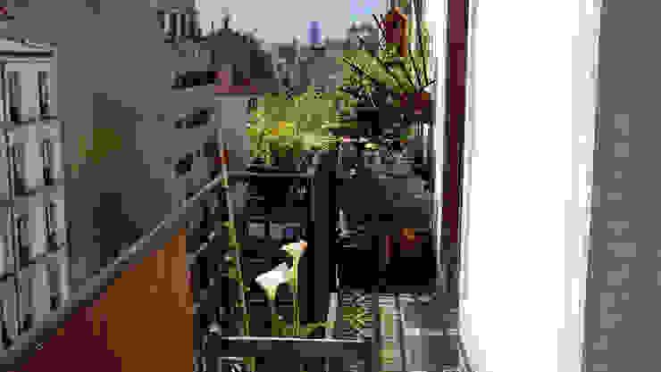 Appartement Bohème Balcon, Veranda & Terrasse originaux par Harfang Decoration Éclectique