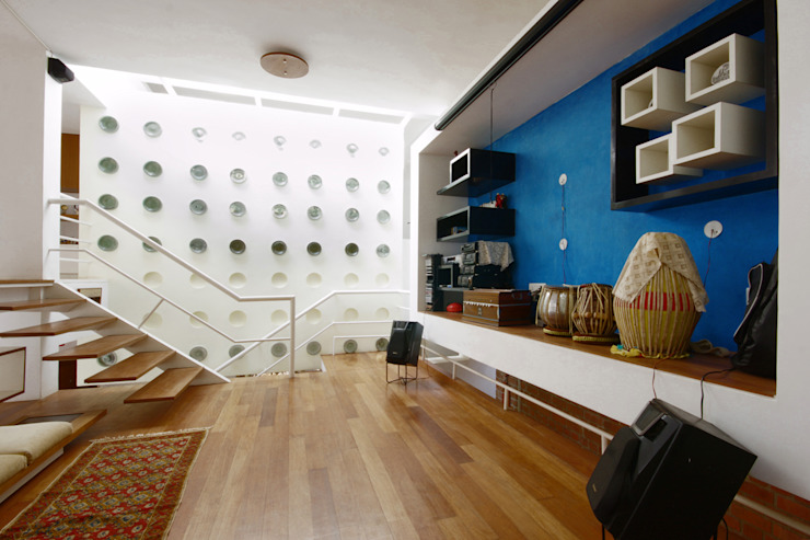family room: modern  by Gaurav Roy Choudhury Architects,Modern