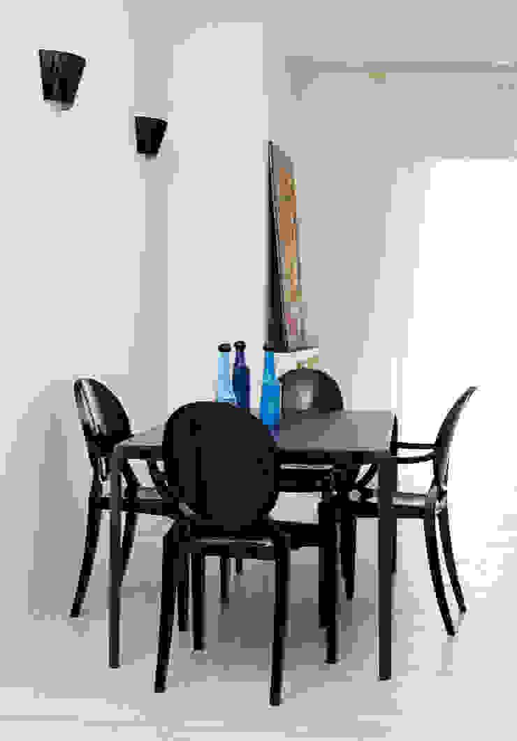 VIA CIPRO Sala da pranzo moderna di Flussocreativo Design Studio Moderno