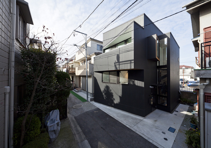 House in Shimomaruko par アトリエハコ建築設計事務所/atelier HAKO architects Moderne