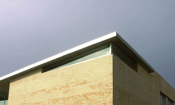 Detalle de la fachada exterior de Argola Arquitectos Moderno