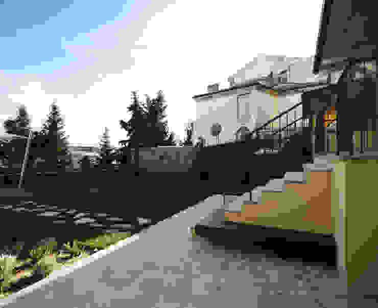 Casa in centro storico Giardino moderno di Luca Mancini | Architetto Moderno