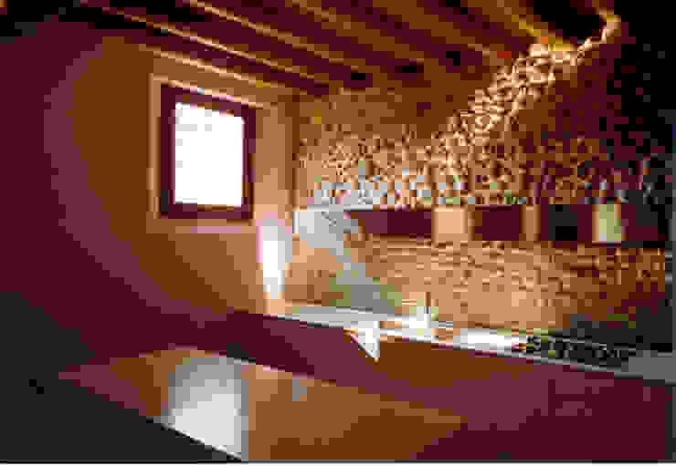 Zona cucina-pranzo di Abaco Associati Minimalista