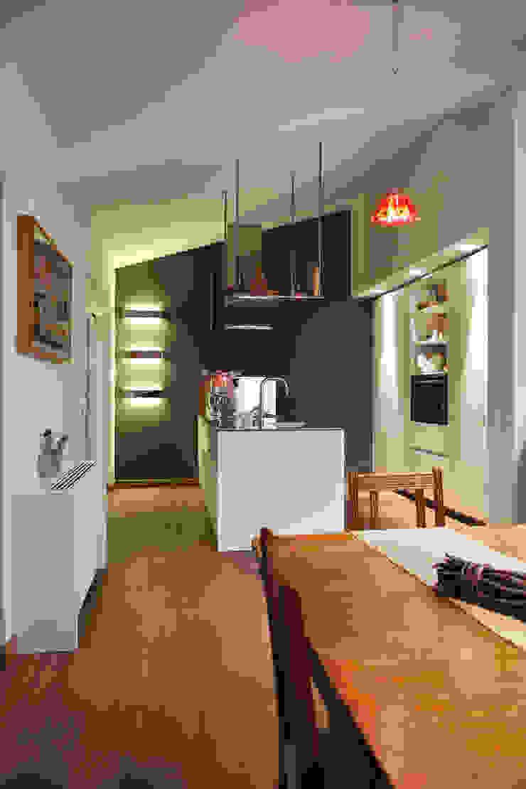 Attico in città di pucci+saladino architects Moderno