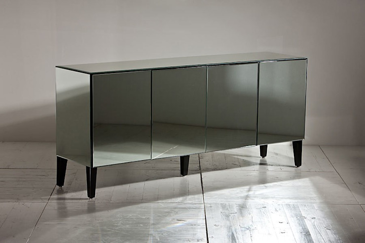 Dining room by Ámbar Muebles