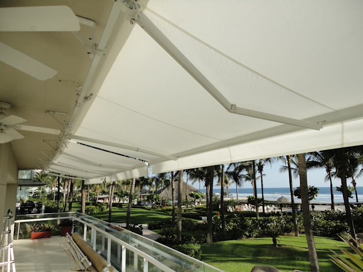 Toldo retráctil Balcones y terrazas modernos de Arquiindeco Moderno